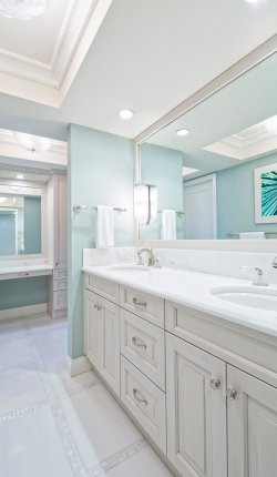 Beautiful remodeled master bathroom with double sink and vanity in the background (Picture on wall is mine)